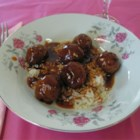 Sweet and Sour Meatballs II - Meatballs are made with ground beef, onions, egg, and bread crumbs, browned in a skillet, and simmered with vinegar, soy sauce, cornstarch, ketchup, and sugar until the sauce thickens.