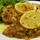 Chicken Francesa - Breaded and baked chicken is topped with a white wine reduction creating a fancy main dish for dinner parties or romantic dinners.