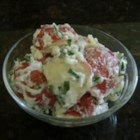 Red Potato Salad with Sour Cream and Chives - Red potatoes and lots and lots of snipped chives give this simple potato salad pizzazz. The dressing is very creamy and adds the finishing touch.