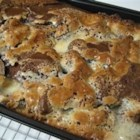 Hurricane Cake - An easy and delicious cake, also known as Earthquake Cake. Coconut and pecans are baked under a German chocolate cake mix, with a cream cheese mixture on top that sinks into the batter as it bakes.