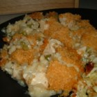 Almond Chicken Casserole II - Mayonnaise and soup stirred into cooked chicken breast and rice with a little onion/celery saute, then topped with slivered almonds and cereal crumbs. Fantastic casserole. This recipe was catered in for my sister's wedding.  Everyone wanted the recipe, it is sooo good!