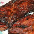 St. Louis Pork Steaks - If you are from St. Louis or have relatives here, you know about Pork Steaks! MMMMMM.  This is a family recipe that my whole family enjoys.  I hope you will as well.  The seasoned cider vinegar leaves grilled pork steaks nice and juicy.