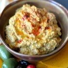 Baba Ghanoush - This wonderful dip is made with roasted eggplant, tahini, lemon and lots of roasted garlic.   Even if you don't usually like eggplant,  you just may love this.  It is the perfect starter for a Middle Eastern dinner.