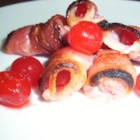Bacon Wrapped Cherries - Broiled cherries wrapped in bacon are quick and easy enough to impress unexpected guests and tasty enough that they might not leave.