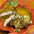 Red Snapper in Grape Leaves with Garlic and Caper butter - Red snapper fillets are encased in grape leaves before being broiled and served with a lemon butter sauce. A quick meal that is truly elegant.