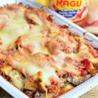 Layered Chicken Parmesan Gnocchi Bake - Gnocchi, mushrooms, and chunks of chicken are baked with layers of chunky tomato sauce and lots of cheese for this hearty family pleaser.