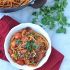 Easy One-Pot Pasta Puttanesca - Pasta and sauce simmer together, along with kalamata olives, capers, garlic, and tomatoes for a quick weeknight dinner with easy clean up.