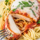Weeknight Baked Chicken Parmesan - This baked chicken Parmesan can be served with fresh salad or over hot spaghetti with extra marinara sauce.