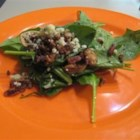 Hot Spinach Salad - Baby spinach is tossed with thin rings of red onion, toasted pecans and crumbled blue cheese and drizzled with a slightly sweet, warm, garlic-infused balsamic vinaigrette.