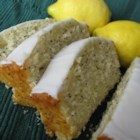 Lemon Poppy Seed Bread - Lemon extract provides the flavor point in this citrus loaf, gilded with a sweetened orange juice sauce.