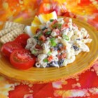 Black Bean Tuna Salad - Tuna salad meets macaroni salad in this recipe also featuring black beans, bacon bits, green onion, and lemon juice.