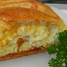 Scrambled Egg Brunch Bread - Perfect for brunch, this beautiful braid is filled with eggs, ham, and cheese. Using refrigerated crescent rolls makes it a snap to prepare.