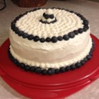 Lemon Blueberry Cake - Lemon cake layered with blueberry pie filling and topped with homemade whipped cream cheese frosting is a delightful cake for any occasion.