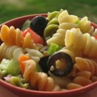 Garden Pasta Salad - Plenty of fresh, crunchy carrots, celery, cucumber, green pepper and onions are tossed with tomatoes, zesty Parmesan and cooked pasta and coated with your favorite Italian-style salad dressing. Chill and serve this bright and flavorful salad.