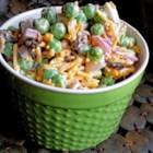 Yummy Summer Pea Salad - Use frozen peas, shredded Cheddar cheese, and cooked bacon to make a quick and tasty pea salad that is perfect for summertime eating.