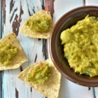 Delicious Non-Traditional Guacamole - Mashed avocado is topped with chopped onion and prepared salsa and season with salt and nutritional yeast for a deconstructed take on a favorite Mexican party dip.