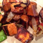 Oven Roasted Sweet Potatoes - This is a simple side dish recipe for sweet potatoes roasted with sweet onion and garlic and finished with a drizzle of balsamic vinegar.