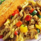 Stoplight Sausage Pasta - Whole wheat pasta with turkey sausage and red, green, and yellow bell peppers is a quick meal to prepare on the stove top.