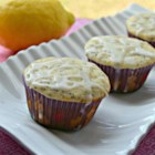 Lemon Poppyseed Muffins with Lemon Glaze - Moist poppyseed muffins with a hint of lemon come alive with a tart lemon glaze. So good you can't eat just one!