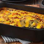 VELVEETA(R) Cheesy Bacon Brunch Casserole - Bacon, eggs and hash browns topped with melty VELVEETA--it's everything you want for brunch in one delicious casserole.