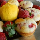 Strawberry Lemonade Muffins - All the tastes of summer are packed into these delightful strawberry lemonade muffins that will have you going back for seconds and thirds.