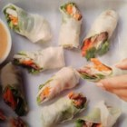 Steak Summer Rolls - Flat-iron steak, homemade pickled vegetables, and cilantro are wrapped in a rice wrapper in this refreshing spring roll recipe.