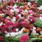 Spinach and Goat Cheese Salad with Beetroot Vinaigrette - A beet vinaigrette is drizzled over baby spinach leaves and walnuts coated with caramelized sugar. Goat cheese brings a final element of distinction to this elegant salad.