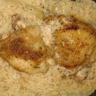 Thighs on Rice - Chicken thighs bake on a bed of rice ideally seasoned with chicken bouillon, butter and onion.  A simple meal that simply tastes great.