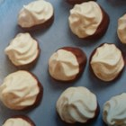 Chocolate-Dipped Coffee Kisses - This recipe for chocolate-dipped coffee kisses produces sophisticated sweet little meringue treats perfect for a dessert table or gift.