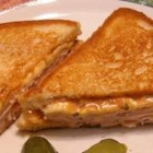 Grilled Hot Turkey Sandwiches - These grilled turkey sandwiches get a spicy kick from pepperjack cheese, zippy salsa, and bright green onions.