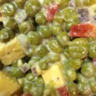 Pea Salad With Pimentos and Cheese - Canned sweet peas, Colby cheese, pimentos, and creamy mayonnaise combine for a tasty, easy salad that's best when chilled overnight.