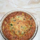 Spinach and Ham Quiche - This 'quiche' replaces a traditional crust with a layer of spinach beneath a mixture of egg, milk, ham, and cheese for an easy brunch dish.