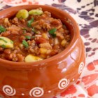 Hobo Beans - This slow cooker recipe delivers a hearty pile of hamburger, bacon, and beans in a thick and sweet sauce.