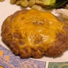 Onion and Cheddar Burgers - Ground beef is mixed with chopped onion and shredded Cheddar cheese, before it is shaped into patties and broiled.