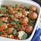 Greek Potato Casserole - This Greek Potato Casserole is courtesy of Running to the Kitchen as part of the U.S. Potato Board's Potato Lovers Club. This Greek Potato Casserole starring red potatoes has a fresh lemony-oregano flavor with kalamata olives and feta.