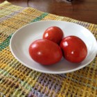 Greek Easter Eggs - Hard-boiled eggs are simmered in a natural red dye made from onion skins in this recipe for Greek Easter eggs.