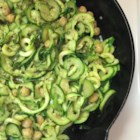 Pesto Zoodles - Zucchini noodles, also known as zoodles, are tossed with pesto and garbanzo beans for a satisfying grain-free meal.