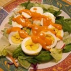 French Salad with Russian Dressing - A variety of lettuce is tossed with egg whites, and topped with cucumbers, carrots, and a delicious, creamy dressing.