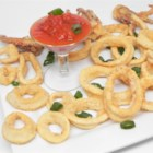Deep-Fried Calamari Rings - Fried calamari rings just like at the restaurant are easy to make at home with ingredients you likely have on hand.