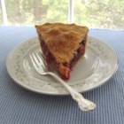 Berry Rhubarb Pie - To make this scrumptious pie, rhubarb, blackberries and raspberries are combined with sugar and flour and refrigerated overnight. This sweet mixture is then spooned into a made-from-scratch crust, topped with another round of pastry and popped into the oven to bake to perfection.
