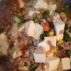 Tofu and Ground Pork with Peas - A quick stir-fry of green peas and green onions with ground pork and tofu makes a delicious topping for a warm bowl of rice.