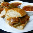 Sausage, Pepper, and Onion Sandwiches - If you can't get to the fairgrounds or your favorite Italian eatery, make these Italian sausage and pepper sandwiches at home. This recipe makes enough for a crowd.