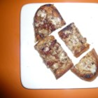 Bacon-Cheese Appetizer Toasts - Top toasted slices of bread with a mixture of bacon, cheese, Worcestershire sauce, and mustard for a fun party appetizer.