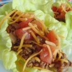 Lettuce Leaf Tacos - Seasoned ground beef, tomatoes, cheese, and bell pepper fill low-carb tacos wrapped in romaine lettuce instead of tortillas or taco shells for a lighter Mexican option.