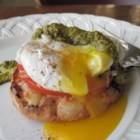 Poached Eggs Caprese - Inspired by eggs Benedict, poached eggs sit atop slices of tomato and mozzarella cheese in this delicious vegetarian breakfast.