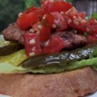 Mexican Turkey Burgers with Pico de Gallo - A delicious twist on the standard burger and traditional burger toppings! Ground turkey burgers seasoned with cumin, coriander, chili powder, and garlic - to name a few - then topped with Pico de Gallo salsa made from fresh tomatoes, onion, and fresh cilantro.