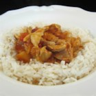 Greek Stew - This old Greek family recipe is a simple stew of chicken thighs in a mixture of white wine and tomato sauce with added flavors of cinnamon and lemon.