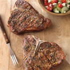 Greek-Seasoned T-Bone Steaks with Cucumber and Tomato Salad - Who said impressive dishes have to be complicated? Iconic T-Bone Steak is grilled then sliced and served with a simple Greek salad.