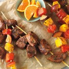 Citrus-Marinated Beef & Fruit Kabobs - Cubes of Top Sirloin are marinated for flavor in a mixture of orange peel, cilantro and smoked paprika. They are then grilled alongside skewers of watermelon, peaches, and mango.