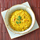Coconut Curried Rice with Cashews - Curried rice with cashews is simmered in coconut water for a flavorful, Asian-inspired side dish to any meal.
